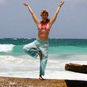 YMCA yoga teacher in dancers pose