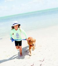 SAND & SHORE: Coolibar T-shirt, $29.50, and swim shorts, $29 for girls; bucket hat, $25, all featuring UPF 50+ sun protection.