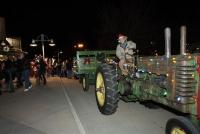 "A tractor gives families rides at the free ""Lakewood Lights"" festival just before Lakewood's mayor ceremonially lights the big Christmas tree."