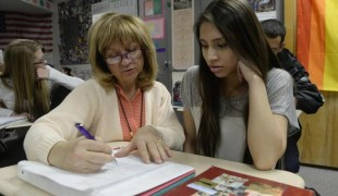 Wheat Ridge High School teacher Stephanie Rossi works with Tanya Ovalle, a 15-year-old student, in her American history class. (Andy Cross, The Denver Post)