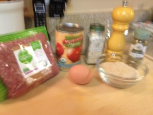 gather your ingredients: 1 lb ground beef 1 egg 1/2 cup bread crumbs 1/4 cup + 1/2 cup tomato sauce garlic salt and pepper