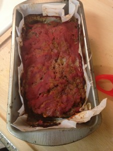 transfer to a loaf pan (i lined mine with parchment paper) and cover with 1/2 cup remaining tomato sauce. bake at 375 degrees for 30-35 minutes or until the internal temperature reaches 160 degrees (or more rare if you like it that way)