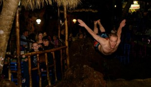 Jason Wuerz dives from a 30-foot-tall indoor waterfall at Casa Bonita restaurant in Lakewood on Friday. Casa Bonita — the place where generations of kids have celebrated their birthdays — marks its 40th anniversary this week. (Hyoung Chang, The Denver Post)
