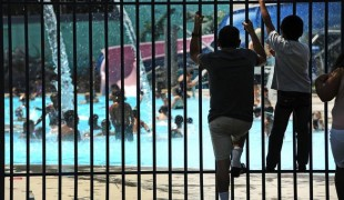 Neighborhood kids watch others swim as they try to beat the heat at the Globeville swimming pool at 4700 Logan Street in Denver, July 21, 2013. (Helen H. Richardson, Denver Post file photo)