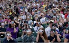 Over 10,000 students watch the big screen at Coors Field using special glass during an interactive science lesson. (RJ Sangosti, The Denver Post)