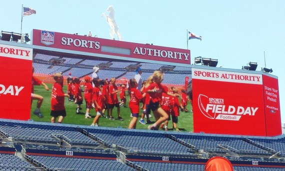 big screen at football field day